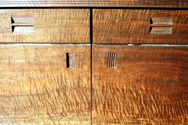 Close-up view of drawers & doors on Beveled Illusion Cabinet by Michael Elkan