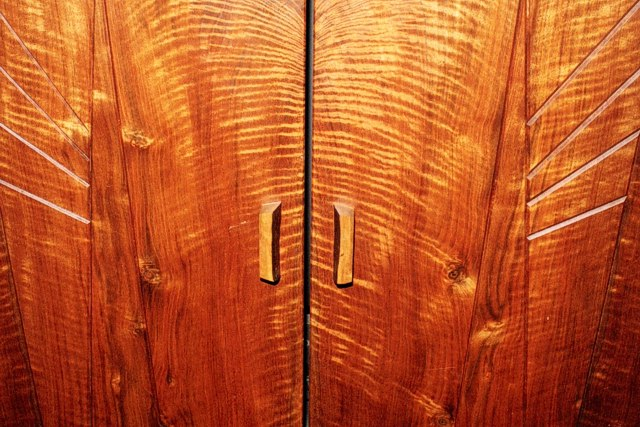 Close-up view of Cabinet with Book Matched Walnut Doors by Michael Elkan
