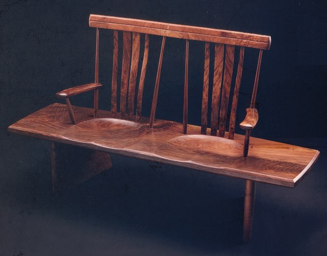 Walnut Bench Seat: single board seat with carved back & steam bent slats by Michael Elkan